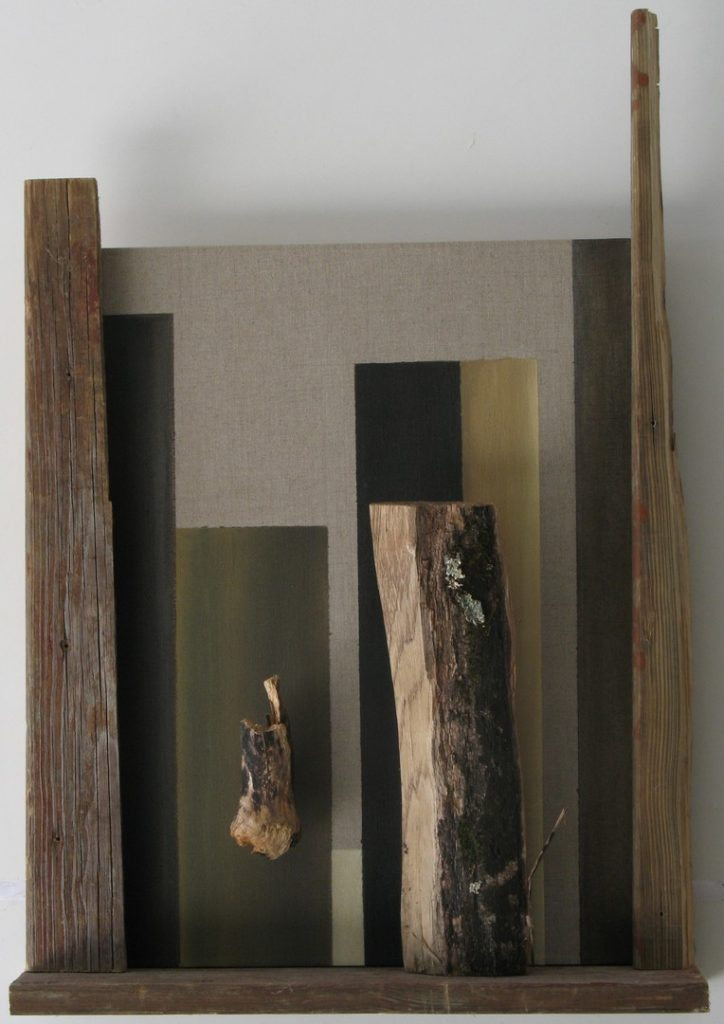 Wood and painted verticals create a vertical progression before a linen canvas by New England artist, Leonard Gerwick.