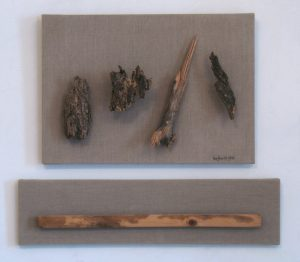 Assemblage of rough wood on two raw linen canvases by Leonard Gerwick