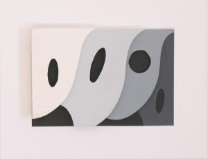 Heavy paper collage of overlapping shapes with round cutouts in a shadow box under glass by Leonard Gerwick