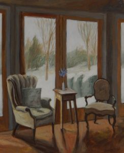 Chairs and table in fron t o wintry scene outside